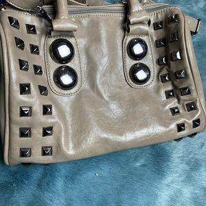 Also handbag with studs